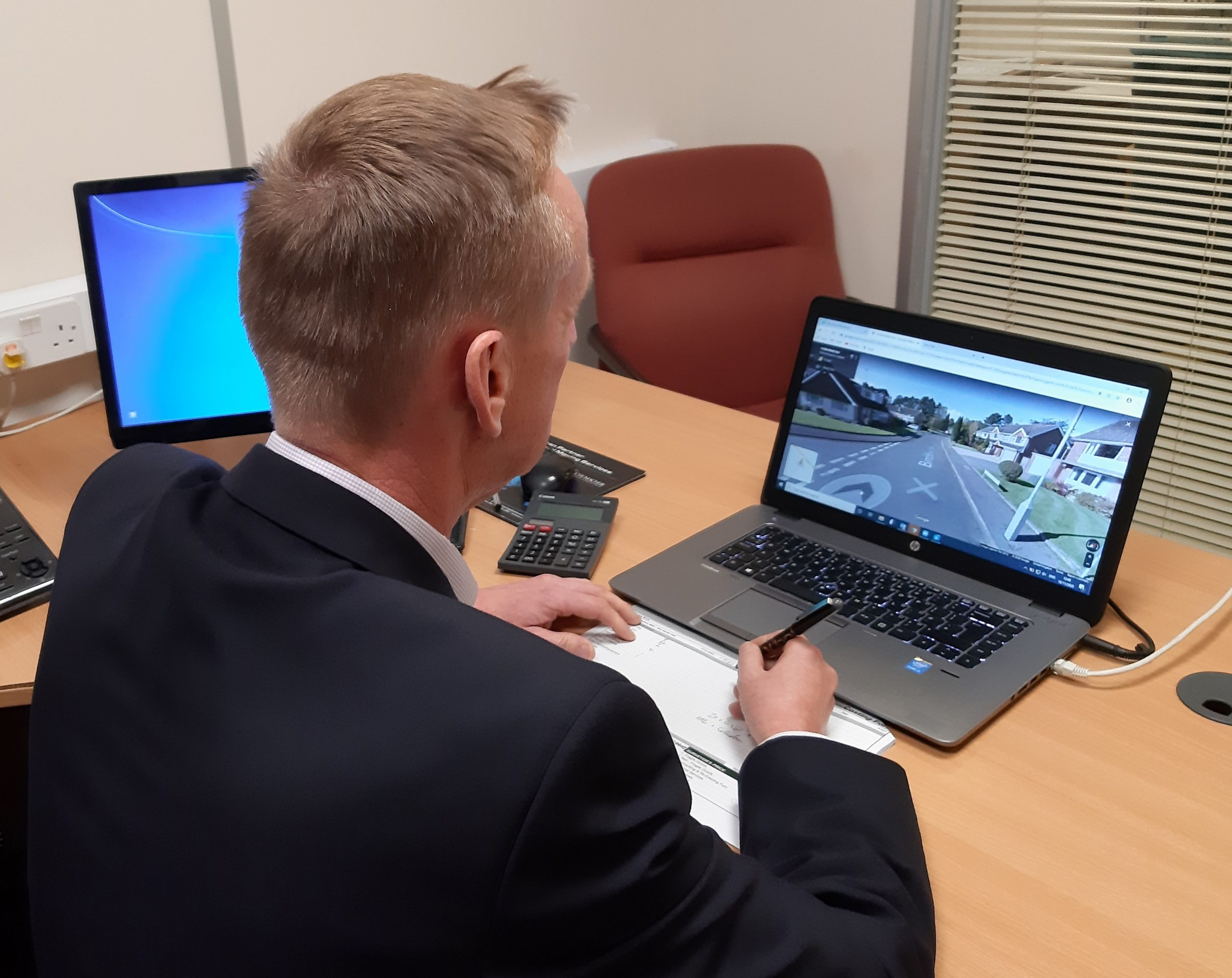 A surveyor performing a virtual house moving survey via video